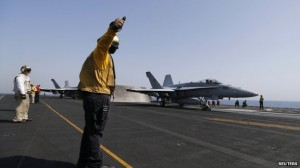 A F/A 18C Hornet Takes Off From An Aircraft Carrier
